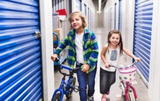 kids taking their bikes to a self storage unit