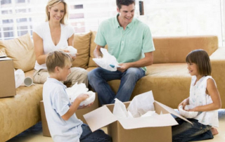 family-in-surry-hills-packing-their-items-ina-box