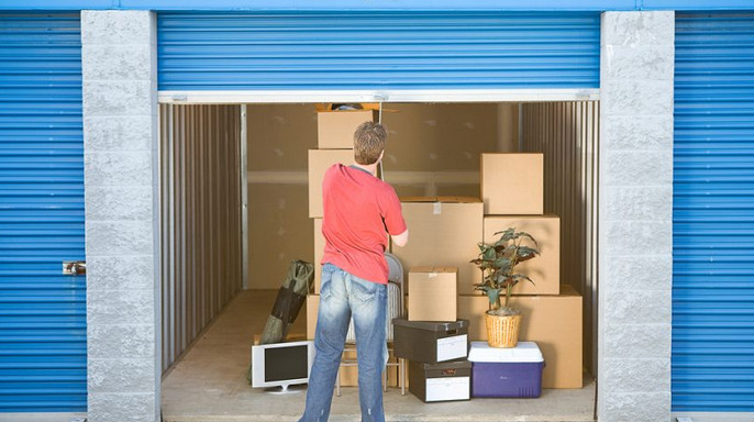 Man storing items in a storage unit
