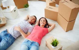 couple resting before going to store boxes in a storage unit