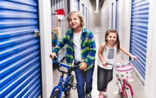 kids taking their bikes to a self storage unit