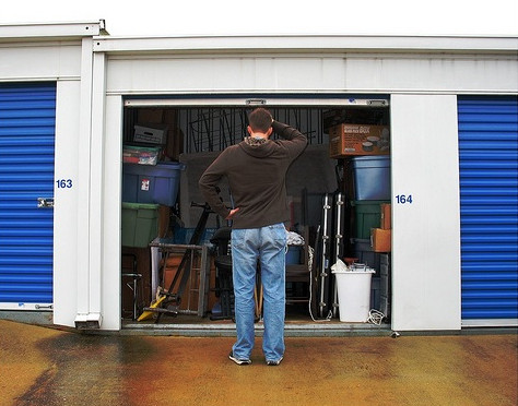 man trying to organize his storage unit