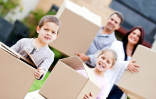 parents and kids moving boxes